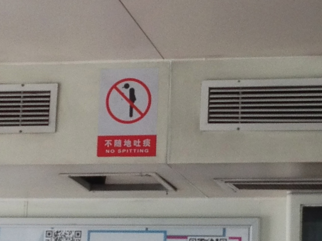 And then back on the ferry,  we're reminded there is no spitting.